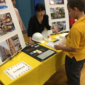 One of our architects tells a student about selecting finishes in relation to a floor plan.